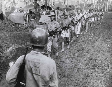 Filipino guerrillas under the command of Captain Jesus Olmedo come out to meet Major General A.V. Arnold at U.S. Army 7th Division headquarters for a conference in 1944. Filipino Guerrillas Under Captain Jesus Olmedo Come Out To Meet 7th Division Command Post For Conference With Major General A.V. Arnold Cropped.jpg