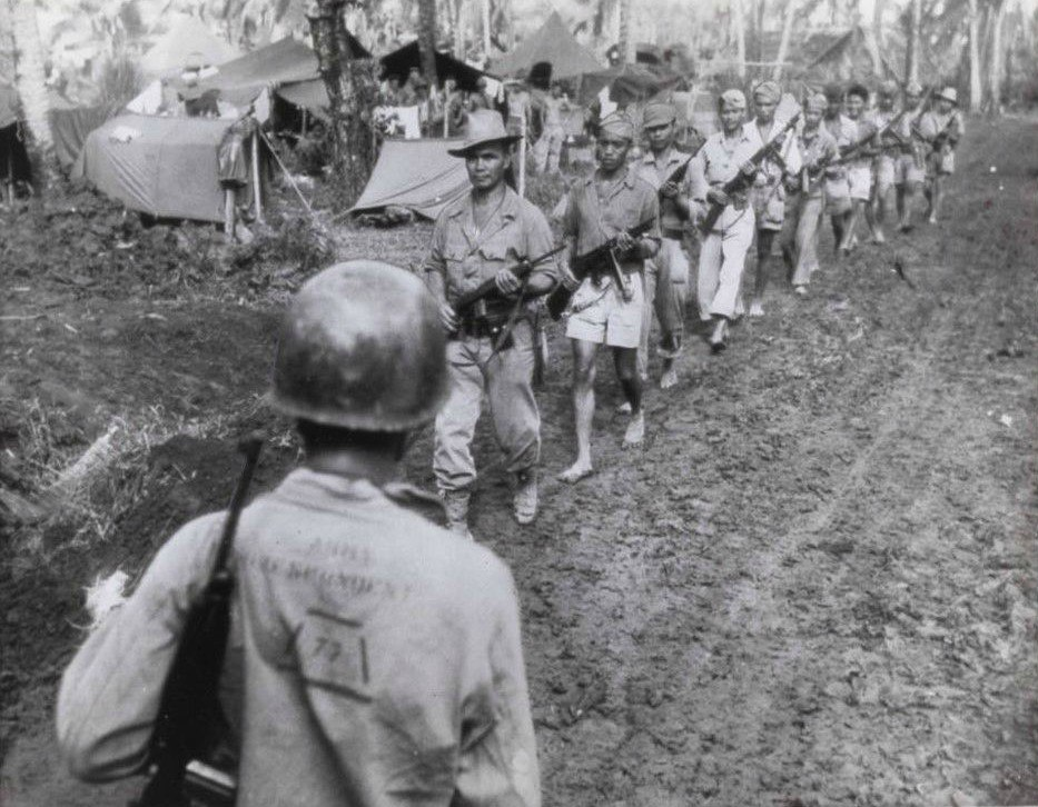 Filipino Guerrillas Under Captain Jesus Olmedo Come Out To Meet 7th Division Command Post For Conference With Major General A.V. Arnold Cropped