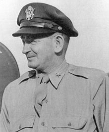 "Head and shoulders view of smiling middle aged man wearing air force ""crush cap""."