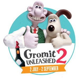 Logo of Gromit Unleashed 2, featuring Wallace, Gromt and Feathers McGraw, as well as the dates '2 July - 2 September', which was the dates of the sculpture trail.