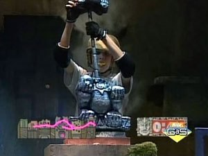 Legends of the Hidden Temple - A contestant assembles a three-piece statue in the Shrine of the Silver Monkey. When the statue is assembled correctly, the unlocked doors of the room open and the contestant can advance toward the artifact, indicated by the pink circle on the map at the bottom left.