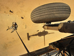 Abseiling - A United States Air Force Pararescueman rappels from a helicopter during a training exercise in Iraq, 2008