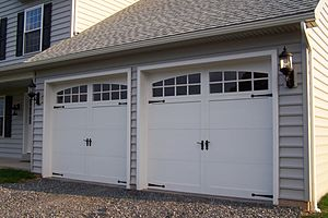 Sectional-type overhead garage doors
