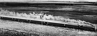 Spirit of Progress - The Spirit of Progress racing an Airco DH.4 aeroplane between Melbourne and Geelong on 17 November 1937