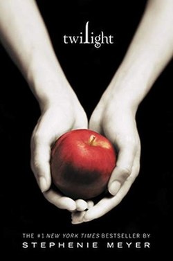 cover of Twilight: two arms and hands from the elbows down, holding a bright red apple. Photo on a black background