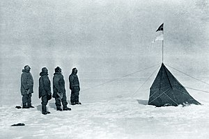 "Polar exploration - Roald Amundsen, Helmer Hanssen, Sverre Hassel and Oscar Wisting (l–r) at ""Polheim"", the tent was upright at the South Pole on 16 December 1911. The top flag is the Flag of Norway; the bottom is marked ""Fram"". Photograph by Olav Bjaaland."