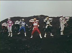 Dengeki Sentai Changeman - Dengeki Sentai Changemen in front of their auto-changers