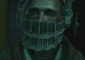 David Tapp - David Tapp as he appears in Saw: The Video Game. Tapp is shown in the Reverse Bear Trap.
