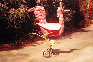 Joe Funk - Joe Funk's mobile sculpture made with a golf cart, Papier-mâché, onion sacks and various other paints and materials