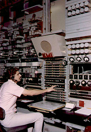 AT&T High Seas Service - Technical Operator at the KMI High Seas Radio control console in Oakland, California, circa 1966.
