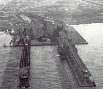 Sewell's Point - Aerial view looking east of Virginian Railway coal piers at Sewells Point, Virginia. The original 1909 pier is at the left. The larger pier to the right was completed in 1925.