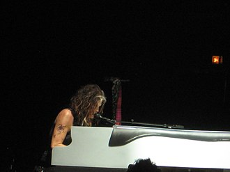 "Steven Tyler - Tyler performing ""Dream On"" on the piano at an Aerosmith concert in Chicago in June 2012."