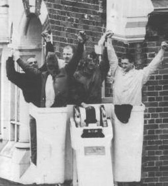 "1990 Strangeways Prison riot - The last five prisoners descend from the roof in a ""cherry picker""—Mark Williams, John Murray, Paul Taylor, Martin Brian and Glyn Williams."