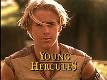 A blond haired teenager wearing a light brown tunic top. At the bottom of the image is the title of the show in yellow capital letters.
