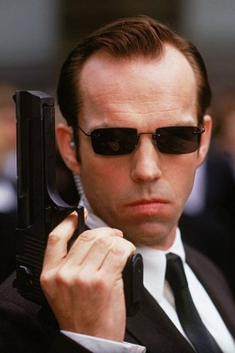 Agent Smith - Hugo Weaving portraying Agent Smith
