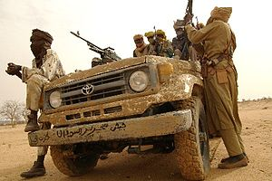 "2000s (decade) - Irregular combatants in North Darfur. The Arabic text on the bumper reads ""The Sudan Liberation Army"" (SLA)."