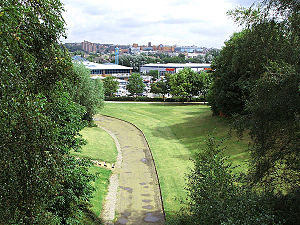 Stoke-on-Trent Garden Festival - The view from the middle of the suspension bridge, looking out over the eastern edge of the retained garden parkland. Beyond, the new out-of-town retail park merges into Stoke-on-Trent's city-centre.