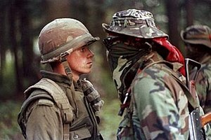 Oka Crisis - Patrick Cloutier, a 'Van Doo' perimeter sentry, and Anishinaabe Warrior Brad Larocque, a University of Saskatchewan economics student, facing off became one of Canada's most widely circulated images.
