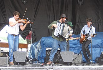 The Felice Brothers - The Felice Brothers at Mountain Jam 2008. Left to Right, Farley, James, Christmas (In Back), Ian