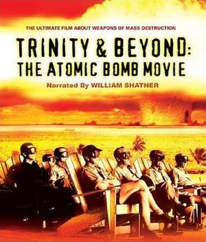 Trinity and Beyond - Cover of the 2009 Blu-ray release, seated VIPs on shot Greenhouse Dog with Crossroads Baker in the background.