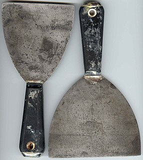 Putty knife hand tool mainly used for filling or stripping material (picture is of a broad knife, not a putty knife)