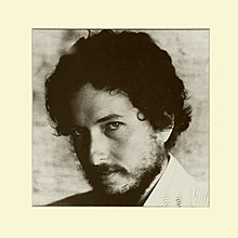 A black-and-white photograph of Bob Dylan