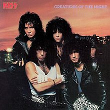 The 1985 re-release cover pictures then-new lead guitarist Bruce Kulick (bottom right).