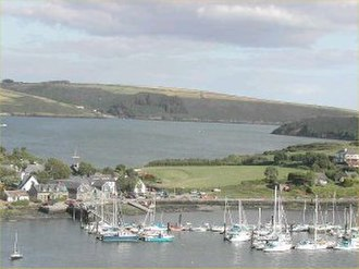 Castlepark - The marina at Castlepark in 2002, looking south-eastwards from Compass Hill on the Kinsale side of the Bandon River. The image also shows the village which straddles the neck of land joining the James's Fort townland to the main body of the peninsula. James's Fort, which is not pictured, is off to the left