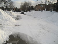 A picture of a road in Markham in the winter.