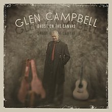 "The album cover features Campbell wearing a long black coat standing with an open guitar-case to his right and an acoustic guitar to his right. Above him are the words ""GLEN CAMPBELL / GHOST ON THE CANVAS"" written in white."