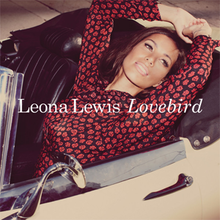 "A brunette woman sits in an open convertible looking into the distance, wearing a polka dot red top. It says the name of the artist ""Leona Lewis"" in the Century Schoolbook type-face followed by the title of the song, ""Lovebird""."