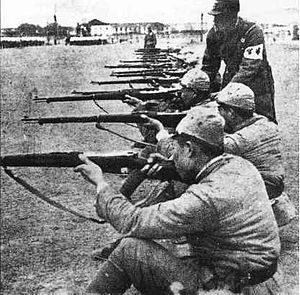 Collaborationist Chinese Army - Reformed Government troops undergoing training with Hanyang 88 rifles under a Japanese instructor.