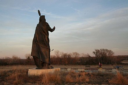 "The statue of Standing Bear honors the Ponca chief who successfully argued in U.S. District Court in a landmark civil rights case in 1879 that Native Americans are ""persons within the meaning of the law"" and have the rights of citizenship. Statue of Standing Bear seen from West.jpg"