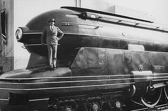 Raymond Loewy - Loewy standing on one of his designs, the Pennsylvania Railroad's S1 steam locomotive