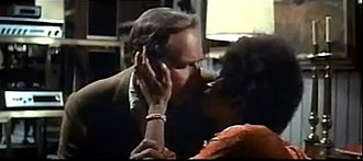 The Omega Man - Charlton Heston and Rosalind Cash about to kiss in a scene from The Omega Man