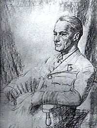 Half-portrait of seated man in military uniform