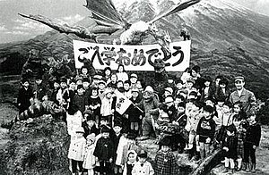 Destroy All Monsters - School children visiting the set during production, pose with some of the cast, monster suits and props.