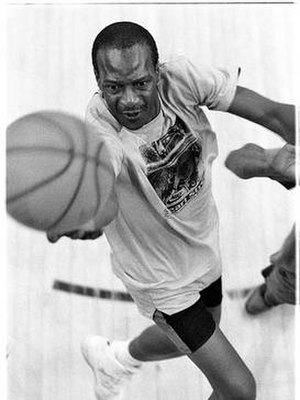 """Earl Manigault - Earl """"The Goat"""" Manigault shooting a basket in 1991 at an indoor court in Harlem. Manhattan, New York City. (Photo by Charlie Samuels.)"""