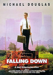 "A poster depicting an older man standing on a concrete platform, wearing a business outfit, holding a briefcase and a shotgun. Above in black letters it reads: ""Michael Douglas"". Below in large white letters over a red background it reads: ""Falling Down"". Beneath that with the film credits, it reads in small white letters: ""A Joel Schumacher Film"". In the background are skyscrapers and a smog filled sky."