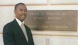 Tompkins v. Alabama State University - Tompkins posing in front of U.S. Federal Court House Montgomery, Alabama