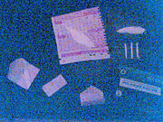 Wraps of cocaine. Wraps are used to distribute cocaine by street-level dealers.