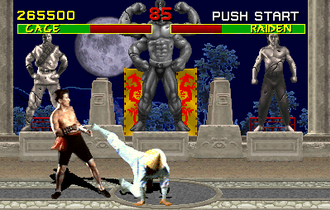 Mortal Kombat - Screenshot of a fight between Johnny Cage and Raiden (played by Daniel Pesina and Carlos Pesina) in 1992's game