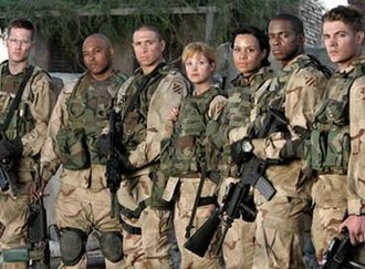 Over There (U.S. TV series) - The cast of the pilot episode of Over There (left to right: Luke Macfarlane, Kirk Jones, Erik Palladino, Nicki Aycox, Lizette Carrión, Keith Robinson, Josh Henderson).