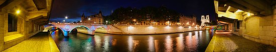 Panoramic view of the Seine in Paris with St-Michel bridge on the left and Notre-Dame cathedral to the right