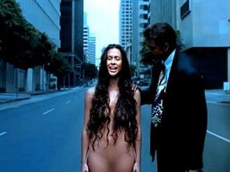 Thank U - A stranger (actor/producer Sanjay Pandya) places his hand on Morissette as she stands in the middle of the street.