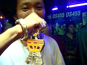 Japanese hip hop - Japanese Hip-Hop fan sports an Afro and shows some Japanese style bling