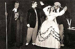 A sepia photo showing four characters, the Usher, the Defendant and the Plaintiff swooning in the arms of the Judge.