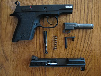 CZ 2075 RAMI - The CZ 2075 RAMI field stripped. The frame, barrel, slide pin, recoil spring, and slide lock are visible.