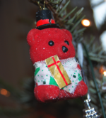 A toy bear christmas decoration.