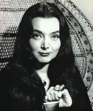 Carolyn Jones as Morticia Addams in the 1960s ...